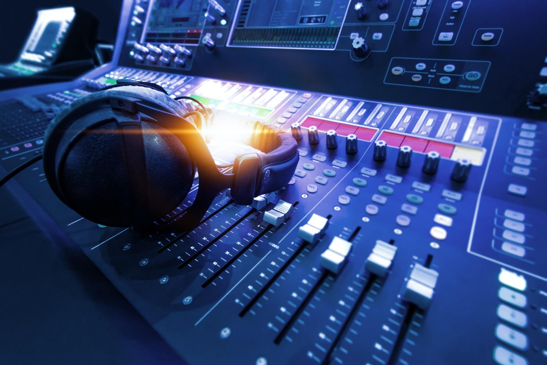 Radio station soundboard with headphones on it