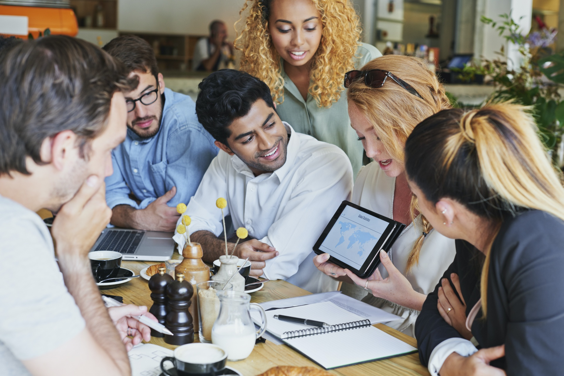Group of coworkers looking at a tablet